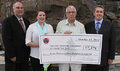 IMAGE Oneida Nation, SavON present check to MDA for more than $7,000