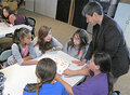 IMAGE Joseph Connolly, NASA, works with Oneida Nation Summer Jam participants.