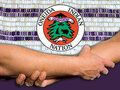 IMAGE Settlement agreement receives formal approval. Image of two people shaking hands in front of Oneida Nation logo
