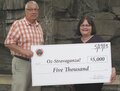 IMAGE Oneida Nation Foundation Presents Check to Oz-Stravaganza Organizers