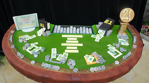 IMAGE - Oneida Indian Nation's Turning Stone Resort Casino celebrated 21 years with an edible replica of the casino's Blackjack (21) table.
