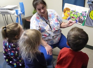 IMAGE Debra Hart reads a story about dental care to the ELC children.