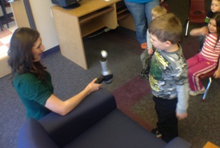 IMAGE Meteorologist Julia Weiden shows children what happens during a rain storm.